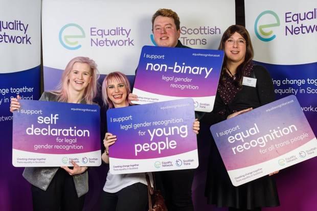 Holding gender recognition placards
